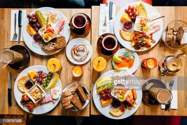 directly above view of brunch food on the table in a restaurant - eettafel stockfoto's en -beelden