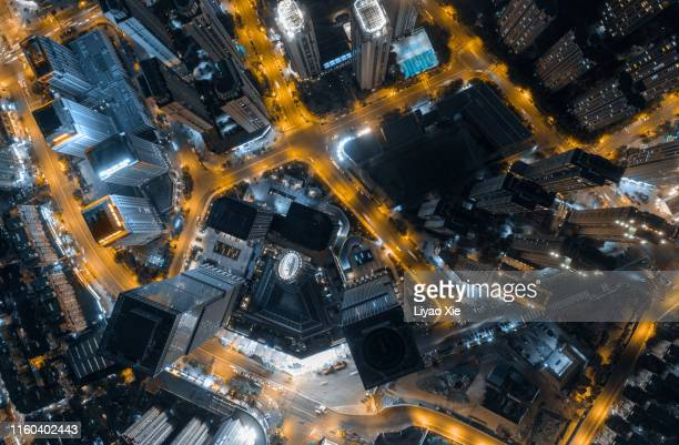directly above view of city at night - liyao xie stock pictures, royalty-free photos & images