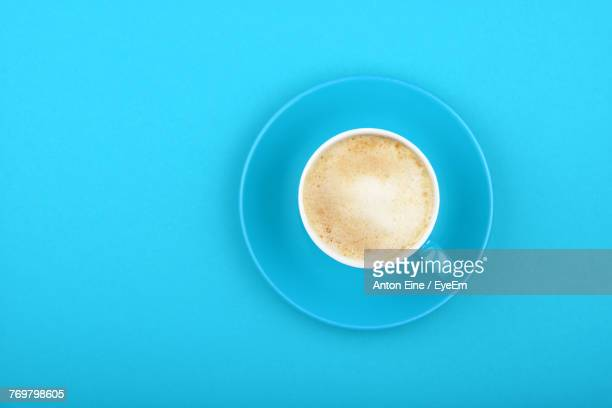 Directly Above View Of Coffee Cup On Blue Table