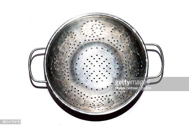 directly above view of colander on white background - colander stock photos and pictures