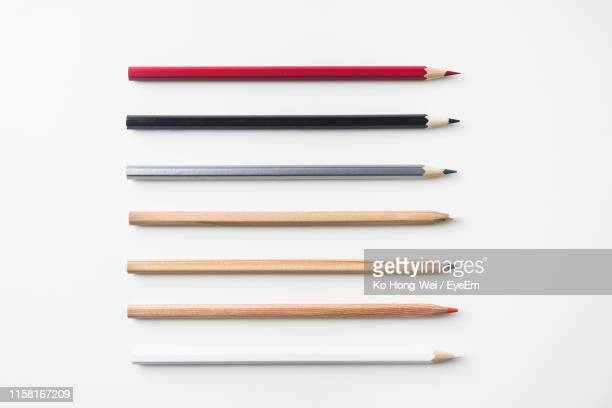 directly above view of colored pencils against white background - 鉛筆 ストックフォトと画像