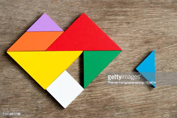 directly above view of colorful toys on wooden table - zweidimensionale form stock-fotos und bilder