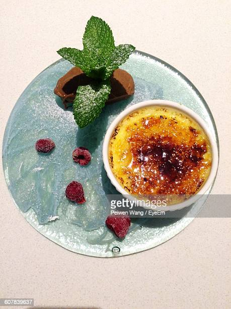 Directly Above View Of Creme Brulee With Chocolate Ice Cream On Table