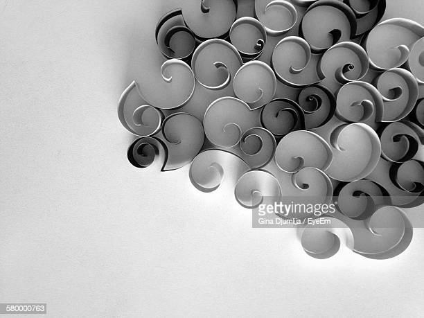 Directly Above View Of Curled Papers On White Background