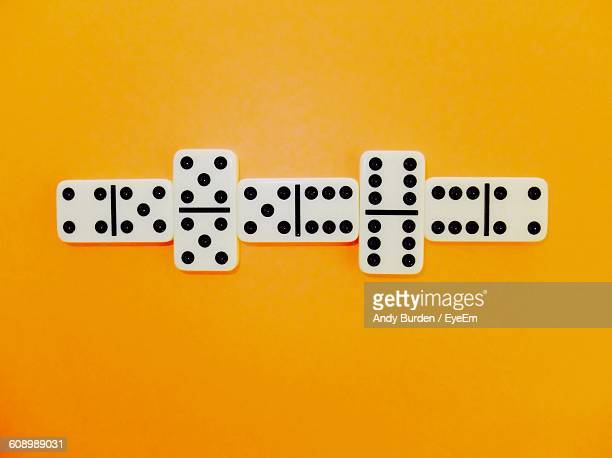 Directly Above View Of Dominoes Against Orange Background