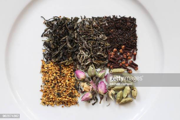 directly above view of dried herbs, spices, tea leaves, and flowers on plate - herbal tea stock pictures, royalty-free photos & images
