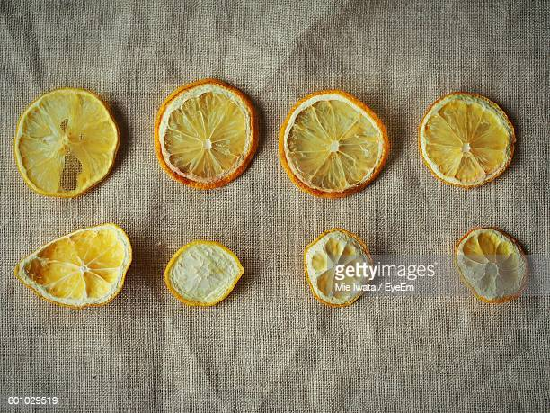 Directly Above View Of Dried Lemon And Orange Slices On Textile