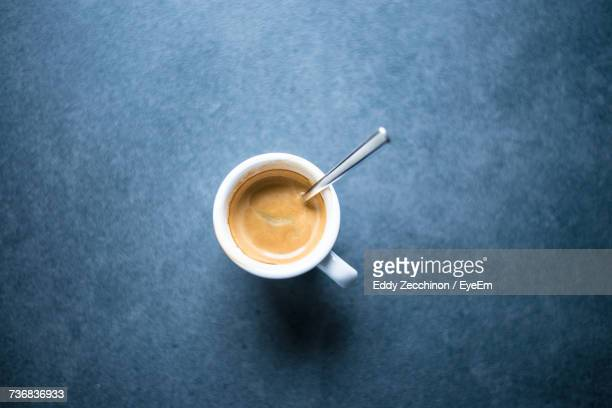 Directly Above View Of Espresso Cup On Blue Table