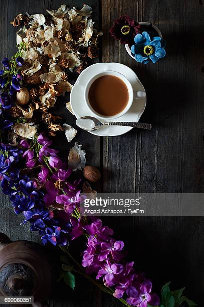 Directly Above View Of Flower Decorations By Tea Cup On Table