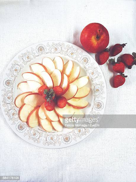 Directly Above View Of Fresh Apple Slices With Strawberries Served In Plate