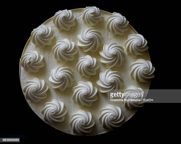 Directly Above View Of Fresh Cake Against Black Background