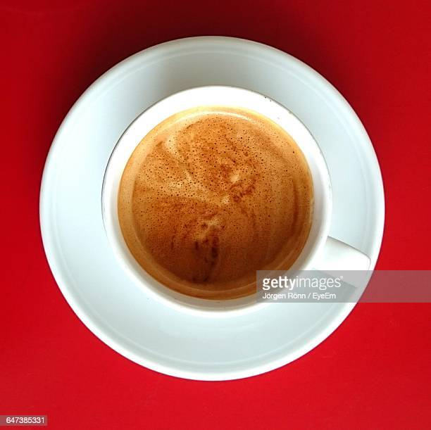 Directly Above View Of Fresh Coffee Served On Red Background
