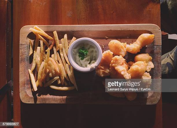Directly Above View Of Fresh Fish And Chips With Mayonnaise Dip In Tray On Table