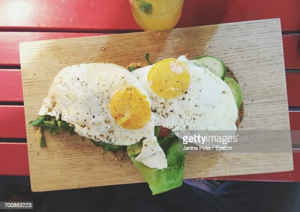 Directly Above View Of Fresh Fried Eggs On Board