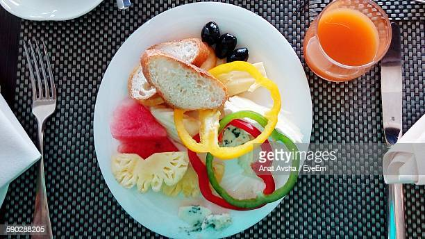 Directly Above View Of Fresh Healthy Breakfast Served With Juice At Hotel Restaurant