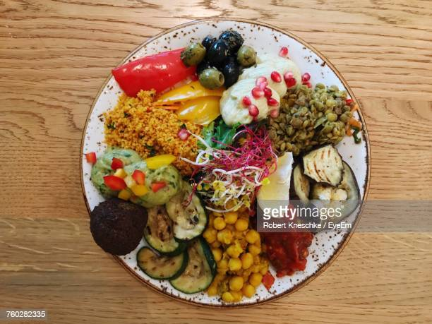 directly above view of fresh meal served in plate on table - antipasto stock photos and pictures