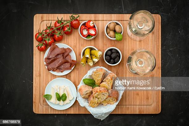 directly above view of fresh meal served on table - antipasto stock pictures, royalty-free photos & images