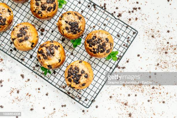 Directly Above View Of Fresh Muffins With Chocolate Chips On Cooling Rack