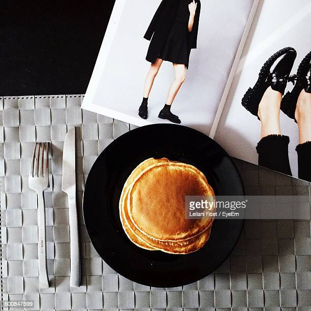 Directly Above View Of Fresh Pancakes With Magazine On Table