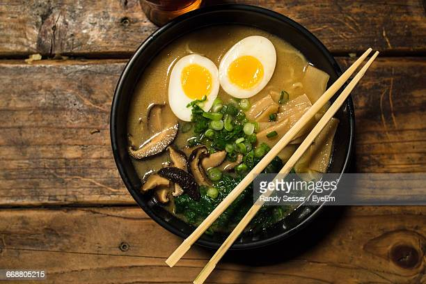 directly above view of fresh ramen noodles served with chopsticks on table - ramen noodles stock pictures, royalty-free photos & images