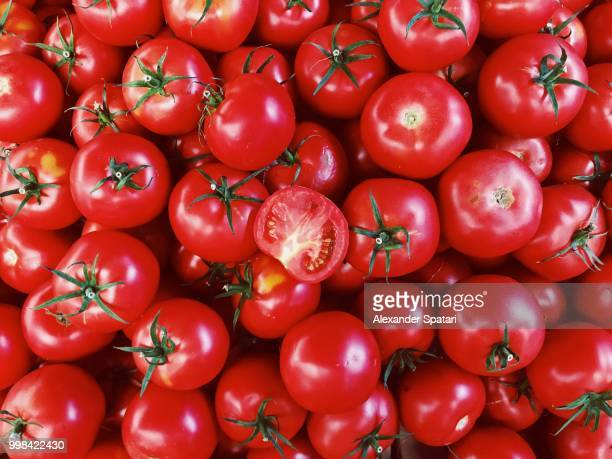 Directly above view of fresh red tomatoes on market stall at the farmer's market