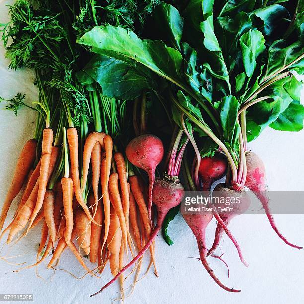 Directly Above View Of Fresh Root Vegetables On White Background