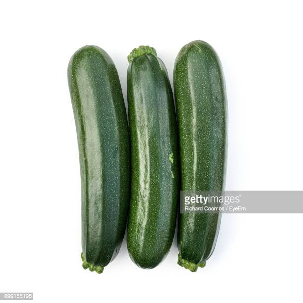 Directly Above View Of Fresh Zucchinis On White Background
