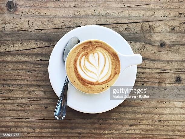 Directly Above View Of Frothy Coffee Served On Table
