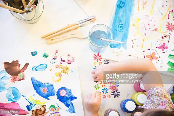directly above view of girl making drawing on desk at home - art and craft stock pictures, royalty-free photos & images