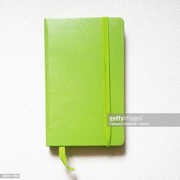 directly above view of green diary over white background - diary stock pictures, royalty-free photos & images