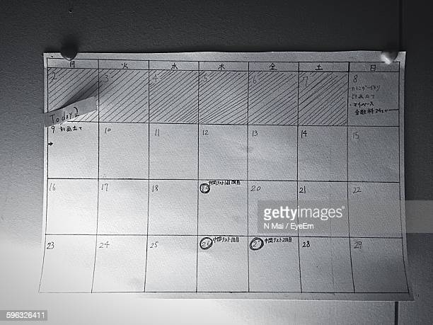 Directly Above View Of Handmade Calendar With Reminders On Table