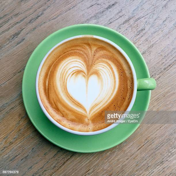 Directly Above View Of Heart Shape Froth Art On Coffee In Cup