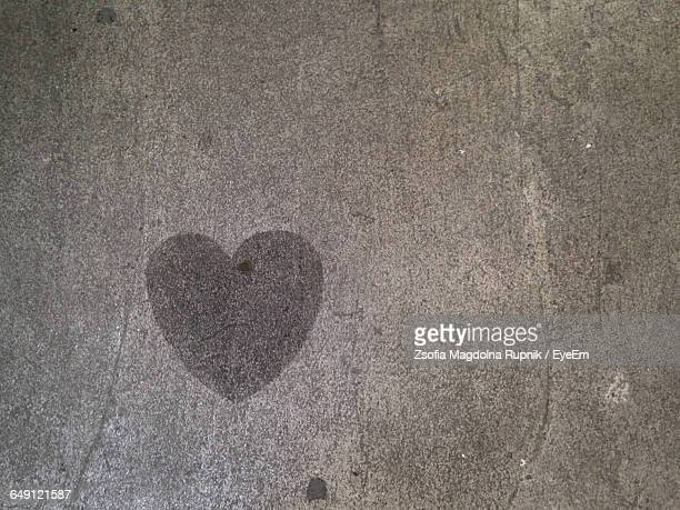 Directly Above View Of Heart Shape On Concrete Floor