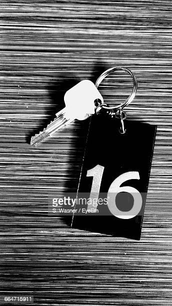 directly above view of hotel key with number on table - hotel key stock photos and pictures