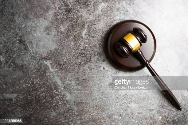 directly above view of judge's gavel on marble stone table background - gavel stock pictures, royalty-free photos & images