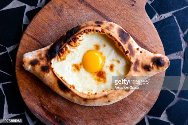 directly above view of khachapuri - traditional georgian pastry with cheese and egg - 国 ジョージア ストックフォトと画像