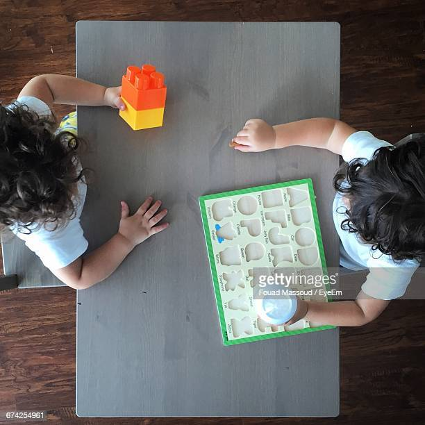 Directly Above View Of Kids With Toys On Table