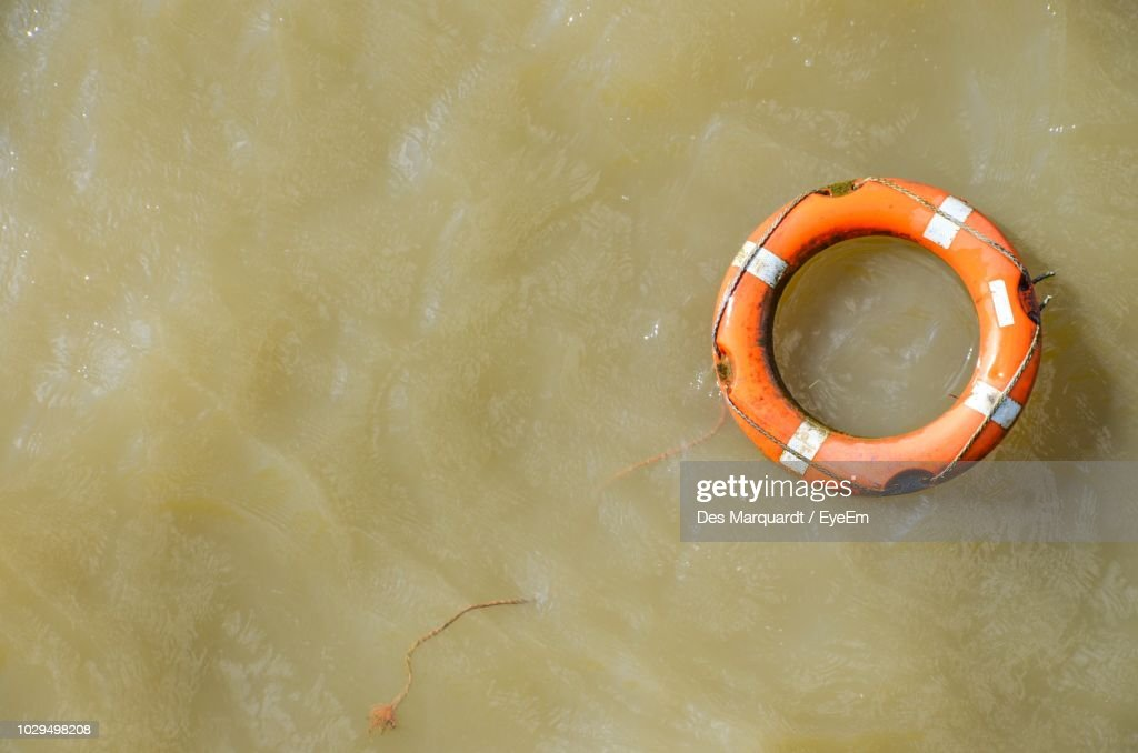 Directly Above View Of Life Belt On Water : Stock Photo