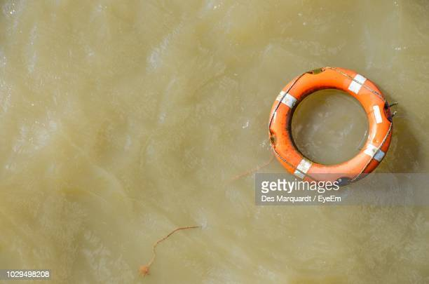 Directly Above View Of Life Belt On Water