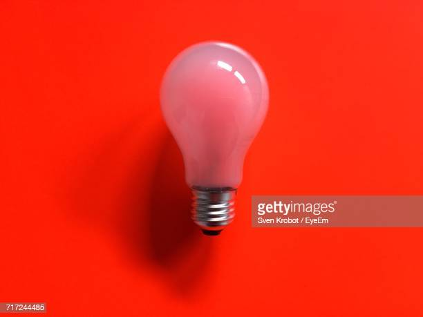Directly Above View Of Light Bulb On Red Background