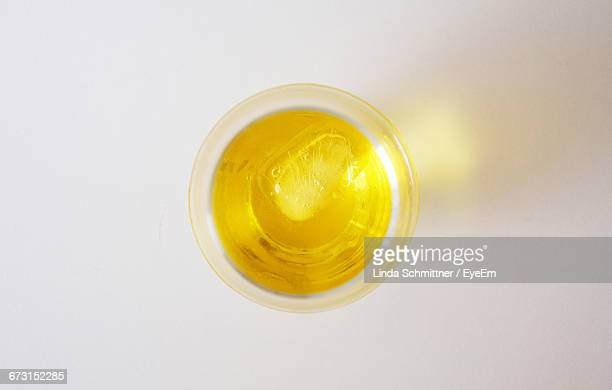 Directly Above View Of Liquor In Glass On White Background