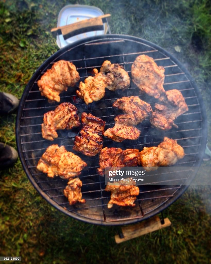 directly above view of meat on barbecue grill ストックフォト getty