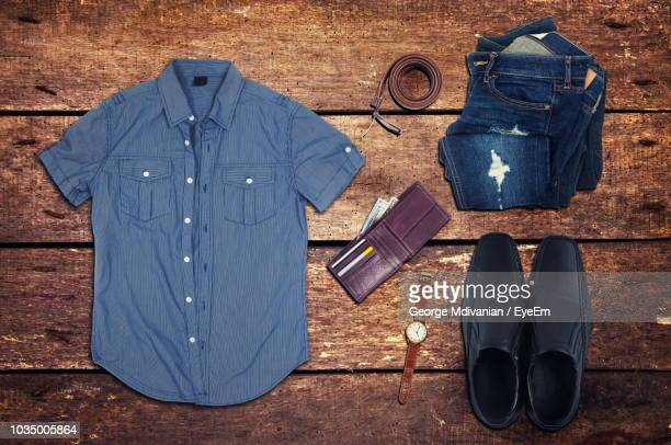 directly above view of menswear and personal accessory on wooden table - men fashion stock photos and pictures