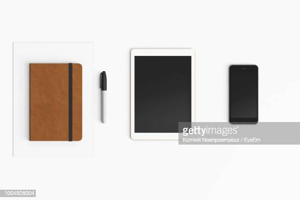 Directly Above View Of Mobile Phone And Digital Tablet Over White Background