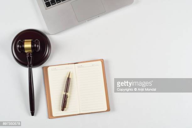 directly above view of modern law firm workplace with laptop, gavel and office articles - legal trial stock pictures, royalty-free photos & images