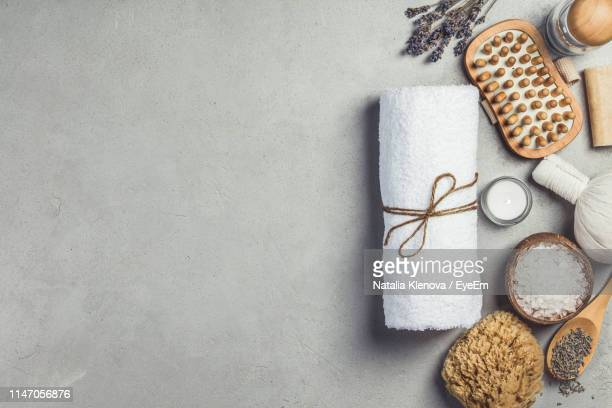directly above view of napkin and products on table at spa - spa stock pictures, royalty-free photos & images