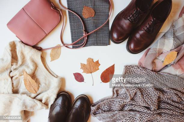 directly above view of objects on table - brown purse stock pictures, royalty-free photos & images