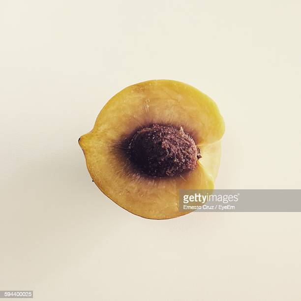 Directly Above View Of Peach Sliced In Halved On White Background