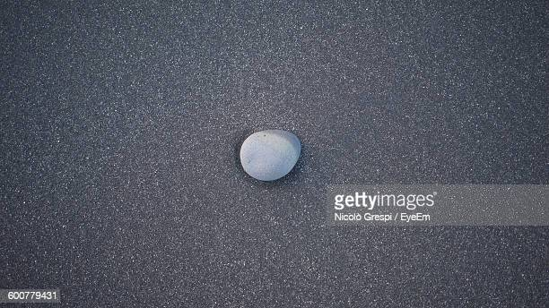 Directly Above View Of Pebble On Road