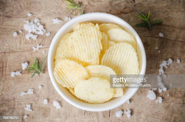 Directly Above View Of Potato Chips In Bowl On Table